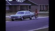 1975: mom toddler bike ride in tandem safety seat on back of bicycle CALIFORNIA Stock Footage