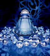 Crystal bottle of perfume and crystal spheres on a dark blue background. Stock Illustration