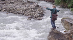 Travel and Adventure - losing balance on rock Stock Footage
