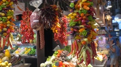 Bunch of peppers in the market La Boqueria in Barcelona Stock Footage