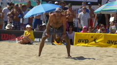 Men playing pro beach volleyball. Stock Footage