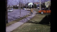 1975: person riding bicycle down street CALIFORNIA Stock Footage