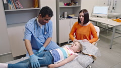 Little Girl at Abdominal Examination Stock Footage