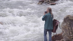 Travel and Adventure - taking picture and putting away camera Stock Footage