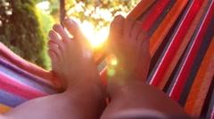 Swinging in a hammock Stock Footage