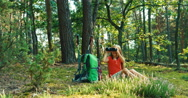 Hiker girl 8-9 years child using binoculars and looking at camera in the forest Stock Footage