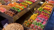 Various sweets in the market La Boqueria in Barcelona Stock Footage
