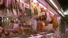Smoked meats in the market La Boqueria in Barcelona Stock Footage