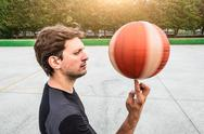 Performance of a white basketball player in the field of road Stock Photos