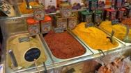 Various spices in the market La Boqueria in Barcelona Stock Footage