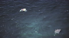 4K Aerial of Crashed Airplane Wrecks Floating on Ocean Cinematic 3D Animation Stock Footage