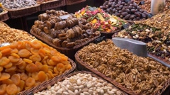 Mixture of dry fruits in the market La Boqueria in Barcelona Stock Footage