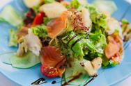 Healthy restaurant food, salmon and cod fish salad closeup Stock Photos