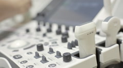 Doctor apply the gel to the sensor of equipment for ultrasound . Stock Footage