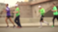 Defocused city marathon runners. Competition concept. Super slow motion Stock Footage