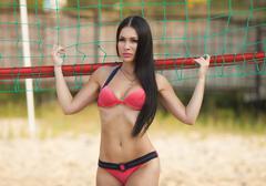 Girl in good shape with long dark hair Stock Photos