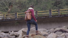 Travelling woman beside highway in ecuador- Stock Footage