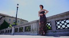 Model posing on bridge in parma pilotta area Stock Footage