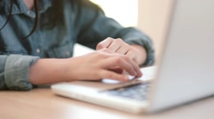 Hands teenage girl working on laptop in the room Stock Footage