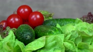 Tomato, cucumber and lettuce vegetables. turntable clockwise Stock Footage