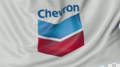 Close up of waving flag with Chevron Corporation logo, seamless loop, blue Stock Footage