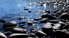 Stones on the shallow water of Lower Multinskoe lake in Altai Stock Footage