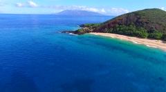 Aerial flight connecting Big Beach and Little Beach, island of Maui, Hawaii Stock Footage