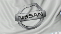 Close up of waving flag with Nissan logo, seamless loop, blue background Stock Footage