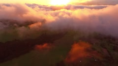 Aerial flight over low tropical clouds over the island of Maui, Hawaii Stock Footage