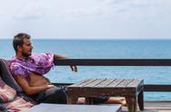 Man resting on the sea Stock Photos