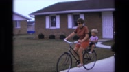 1975: mother and son rides bike CALIFORNIA Stock Footage