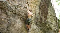 A man rock climbing up a mountain. Stock Footage