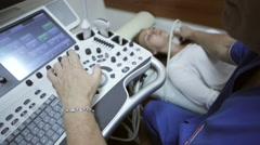 Doctor taking a sonogram of patients neck in the hospital Stock Footage