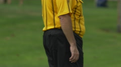 A referee for a boys youth soccer football. Stock Footage