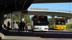 The bus arrives at the bus stop and the passengers boarding. Stock Footage