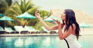 Young woman taking selfie with smartphone Stock Photos