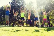 Group of happy friends jumping high outdoors Stock Photos