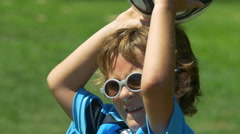 A boy making a throw-in with the ball while playing youth soccer football. Stock Footage