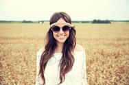 Smiling young hippie woman on cereal field Stock Photos