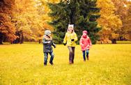Group of happy little kids running outdoors Stock Photos