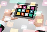 Close up of hands holding tablet pc with app icons Stock Photos