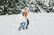 Happy couple running over winter background Stock Photos
