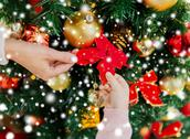 Close up of family decorating christmas tree Stock Photos