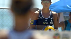 Women playing pro beach volleyball. Stock Footage