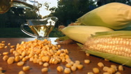 Corn oil and corn on nature. Slow motion. Close-up. Horizontal  pan. Stock Footage