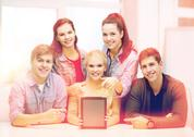Smiling students with blank tablet pc screen Stock Photos