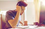 Creative male office worker with coffee thinking Stock Photos