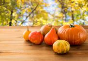 Close up of pumpkins on wooden table outdoors Stock Photos