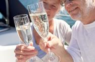 Close up of senior couple with champagne on boat Stock Photos