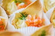 Close up of dough cornet with salmon fish filling Stock Photos